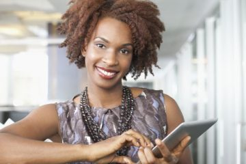 Young smiling woman holding digital tablet, portrait